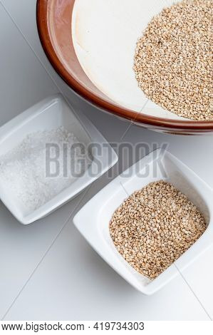 Preparation Of Gomashio (gomasio - Sekihan Seasoning) With Sesame Seeds And Salt In Suribachi (japan