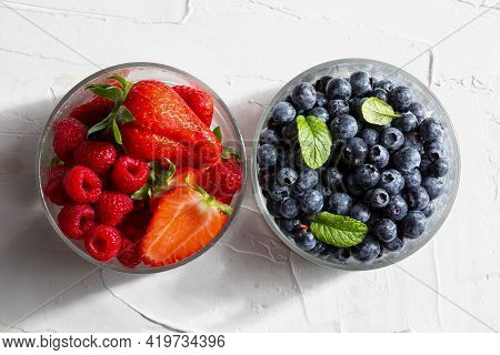 Appetizing Variety Of Forest Fruits (strawberries, Large Strawberries, Raspberries, Blueberries, Red