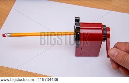 Sharpening A Simple Pencil With A Sharpener.