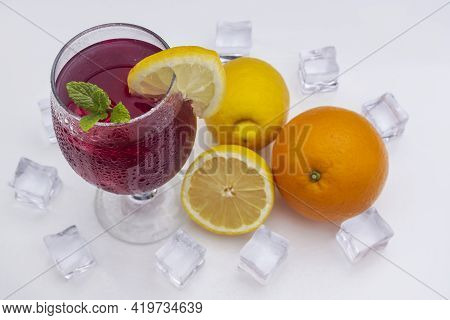 Refreshing Cocktail (red Summer Wine) On White Methacrylate Background. Concept Of Fun And Social Li