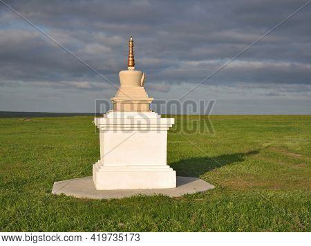 Stupa (buddhist Architectural And Sculptural Religious Building) On The Background Of The Steppe