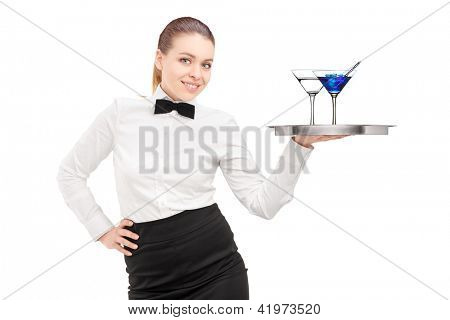 A waitress with bow tie holding a tray with two cocktails on it isolated on white background