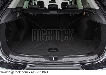 Huge, Clean And Empty Car Trunk In Interior Of Compact Suv. Rear View Of A Suv Car With Open Trunk