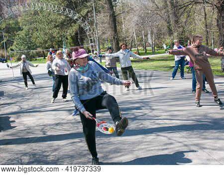 Dnepropetrovsk, Ukraine - 04.22.2021: A Group Of Seniors Doing Health And Fitness Gymnastics In The