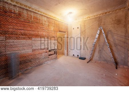 Ladder In The Room In An Apartment That Is Under Construction, Remodeling, Renovation, Extension, Re