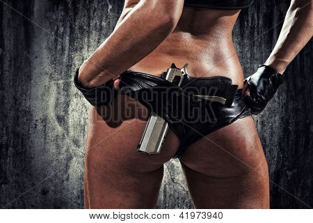 sexy woman with hand gun
