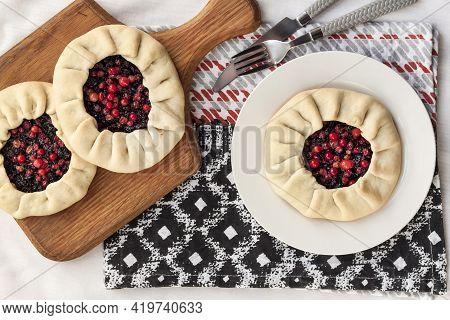 Healthy Breakfast. Homemade Lenten Galette With Elderberries And Cowberries. Flat Lay, Top View
