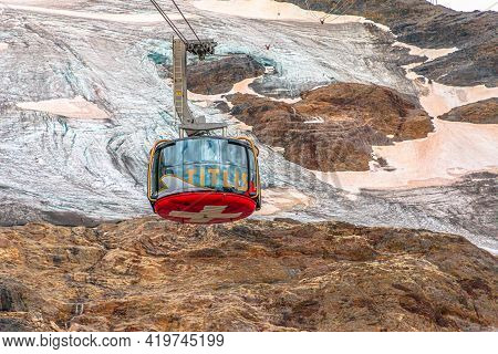 Titlis, Engelberg, Switzerland - Aug 27, 2020: Detail Of Cable Car Cabin With Swiss Flag Of Titlis P