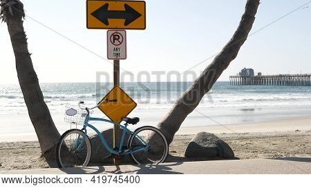 Blue Bicycle, Cruiser Bike By Sandy Ocean Beach, Empty Pacific Coast, Oceanside California Usa. Summ