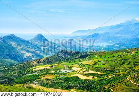 Aerial view of Crete island in Greece with green fields and wineries and flock of sheep grazing