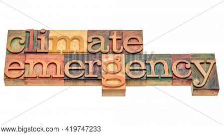 climate emergency - isolated word abstract in letterpress wood type, global warming and change concept