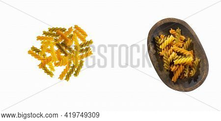 Uncooked Tricolor Fusilli Pasta In The Wooden Bowl
