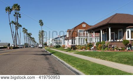 Houses On Suburban Street In California Usa, Oceanside. Generic Buildings In Residential District Ne