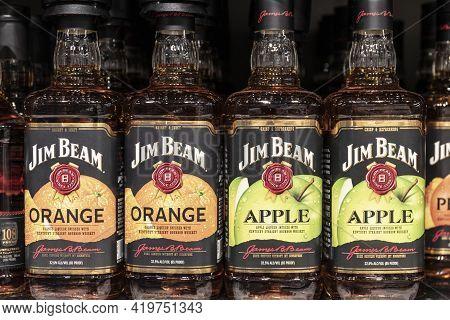 Indianapolis - Circa May 2021: Jim Beam Apple And Orange Whiskey Display. Jim Beam Kentucky Straight
