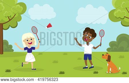 Children Playing Badminton And A Dog Looking At Them. Girl And Boy With Badminton Rackets And Shuttl