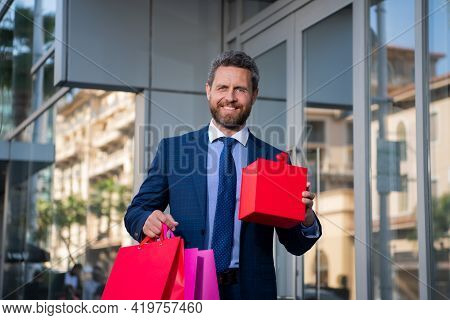 Man In Suit With Shopping Bags. Best Price. Total Sale. Businessman Enjoying Shopping. Excited Smili