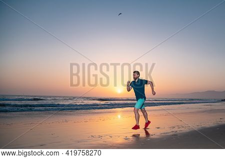 Runner Man On The Beach Be Running For Exercise. Active Healthy Runner Jogging Outdoor. Young Man Tr