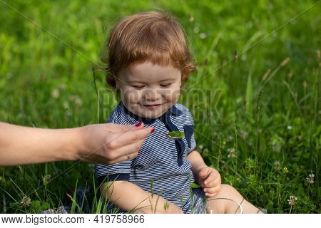 Family, Food, Child, Eating And Parenthood Concept. Mothers Hand Feeding Baby With A Spoon. Spoon Fe