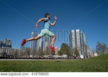 Active Healthy Runner Jogging Outdoor. Healthy Lifestyle Middle Aged Man Runner Running On Urban Cit