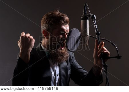 Handsome Man In Recording Studio Gestures With Hands. Music Performance Vocal. Singer Singing Song W