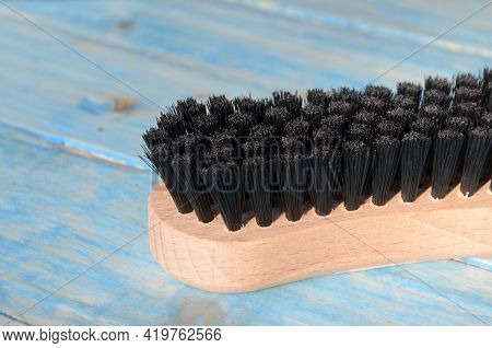New Clothes (or Shoe) Brush With Wooden Handle.clothes Brush On The Table.