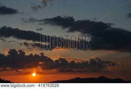 High Resolution Shot Of Sun With Clouds During Sunset Of Hilly Area Of Himachal Pradesh