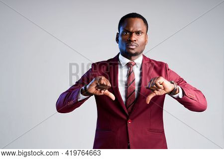 Angry African American Businessman Showing Thumbs Down From Displeasure