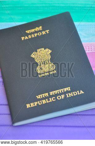 Mandi, Himachal Pradesh, India - 04 24 2021: Closeup Shot Of Indian Passport Over Multi Colored Medi