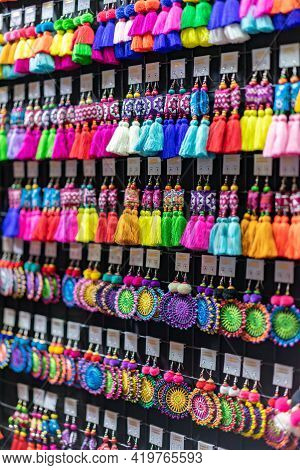 Handmade Souvenir Earring Asian Style Are Hung And Display For Sales In The Shop