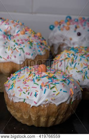 Three Easter Cakes With White Icing And Decorations