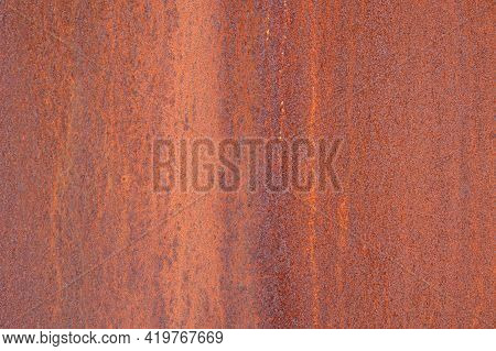 Abstract Background Of The Rusted Metal. Grunge Old Metal Iron Panel. Rust And Oxidized Metal Textur