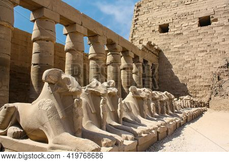 Karnak Temple Complex In Luxor, Egypt. Criosphinxes Alley, Guard Sphinxes With Ram Heads.