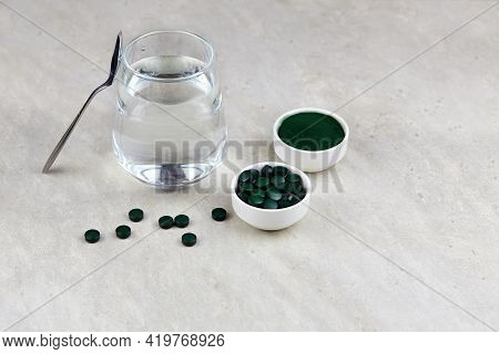 Chlorella Or Spirulina With Water In A Glass On Light Background. Concept Of Superfood And Detox.