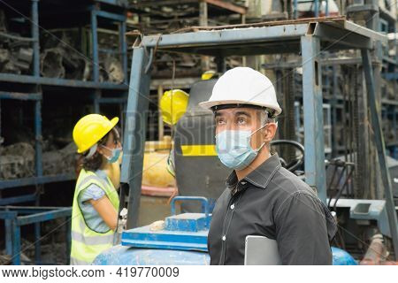 Men And Woman Work Together, Wear Safety Facemask And Looking Above. Caucasian Engineer Man Looking
