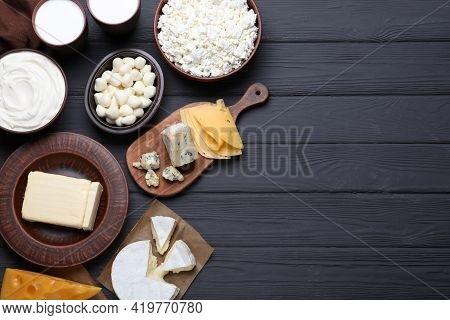 Clay Dishware With Fresh Dairy Products On Black Wooden Table, Flat Lay. Space For Text