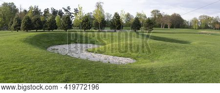 Golf Course, Abandoned Sand Trap. Panorama Of Golf Course, Lawn Grass And Trees Growing On The Terri