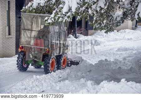 Mini Tractor Clears Snow