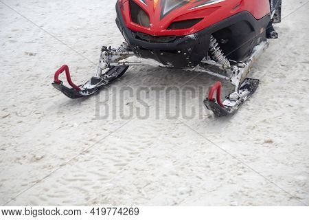 Ski Of Snowmobile In Motion On Dirt Snow