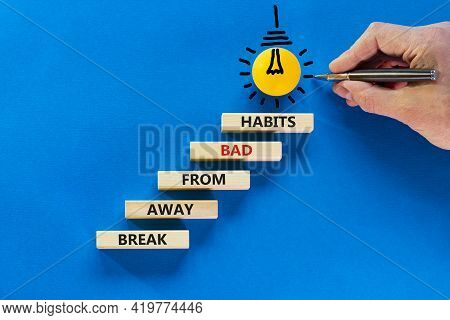Break Bad Habits Symbol. Wooden Blocks On Blue Background, Copy Space. Light Bulb Icon. Businessman