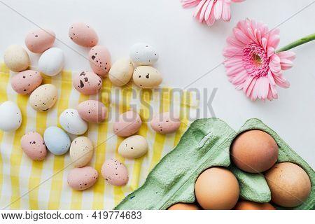 Easter eggs and pink gerbera spring flatlay