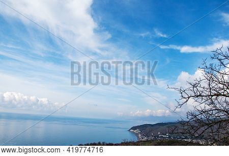Blue Sky With Clouds Over A Beautiful Bay, View From Above. Aerial View Of A Beautiful Coastal View