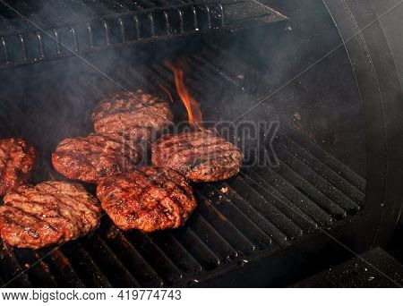 High Angel View Homemade Meat Bbq Burgers Patties For Hamburger Cooking On Flaming Grill Barbecue Wi