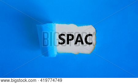 Spac, Special Purpose Acquisition Company Symbol. Words 'spac' Appearing Behind Torn Blue Paper. Bea