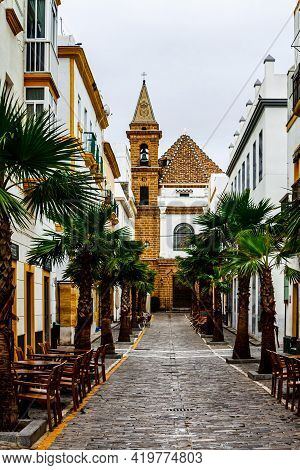 Cadiz, Andalusia, Spain - May 17, 2013: Street Virgen De La Palma With Church Nuestra Senora De La P