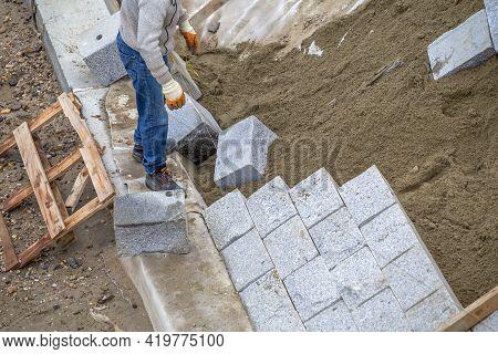 Worker Installing Granite Natural Wall Stone