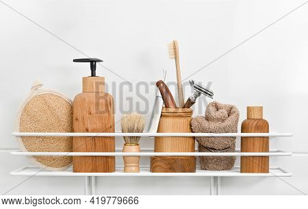 Close Up Natural Wooden Bottles Of Cosmetic Beauty Care Products, Towels, Hygiene, Grooming And Shav