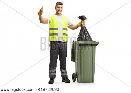 Full length portrait of a waste collector holding a bin bag and gesturing thumbs up isolated on white background