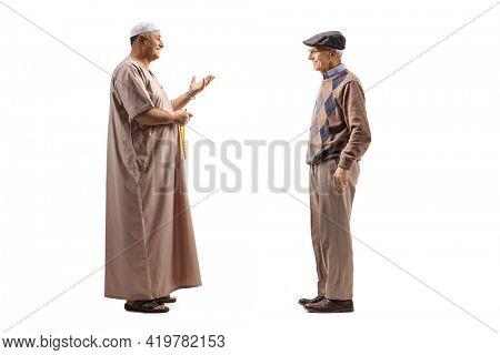 Full length profile shot of a muslim man talking to an elderly man isolated on white background