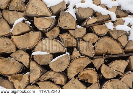 A Pile Of Birch Wood. Prepared For The Winter For Kindling The Village Stove