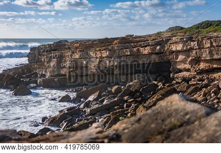 Rocks And Ocean Before The Storm. Amazing View At Coastline, Cliffs And Waves In Cascais, Portugal